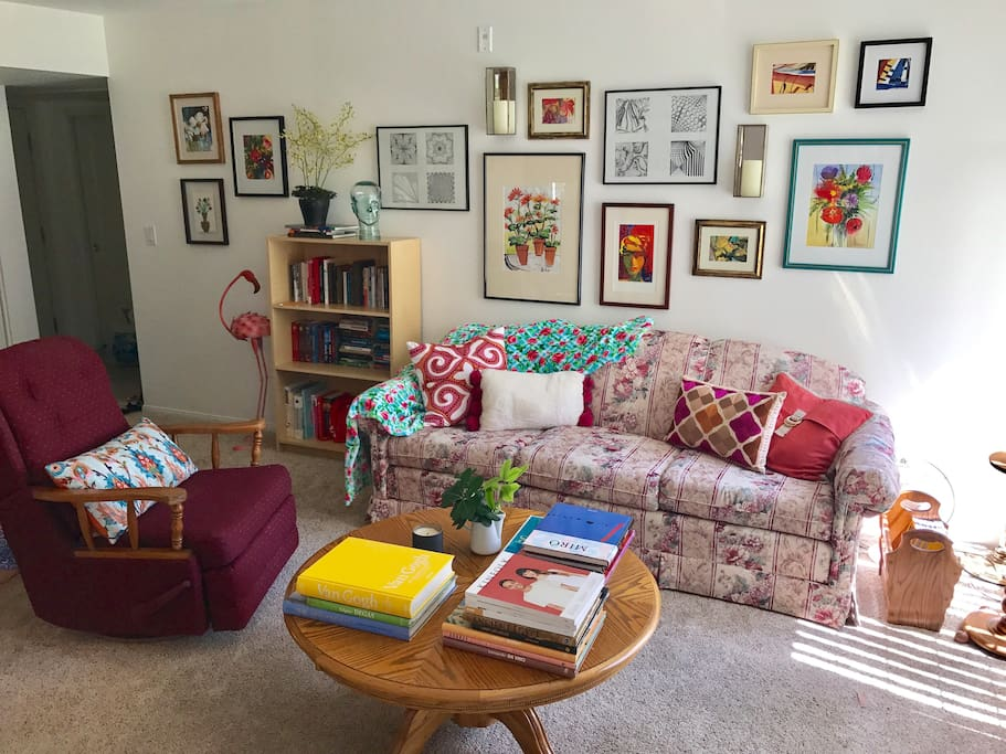 The living room filled with original art by your hostess.