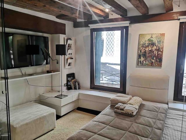 Modern tv is positioned across from the bed for easy relaxation