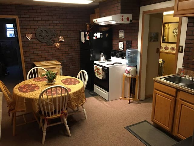 Full size kitchen with fridge,dishwasher, stove and bottled water. Ione Rose Garden Cottage