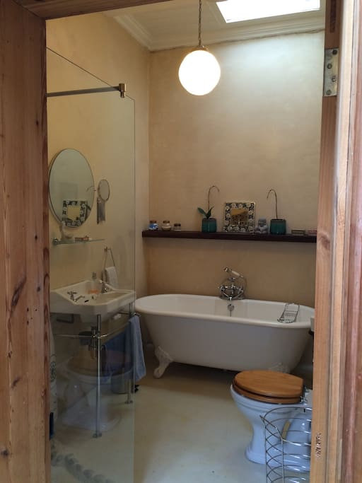 The bathroom in a modernised victorian style has a large tub to saok away stresses ans strains from the day in, or a glassed in shower and big round mirror to talk into to....