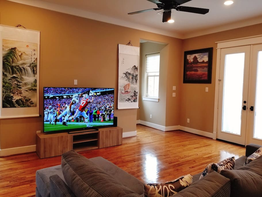 """A great place watch games with your families and friends with 70"""" Smart TV."""