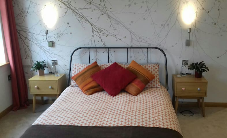 King size bed with reading lights, bedside chests, multi phone / tablet charger and plugs with USB sockets on either side
