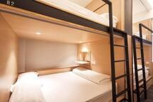 Spacious queen-bed bunk suite