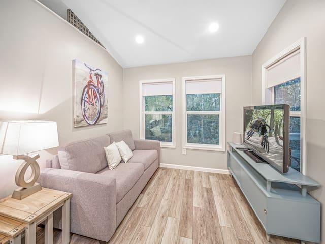 Living room w/ views of woods & wildlife.