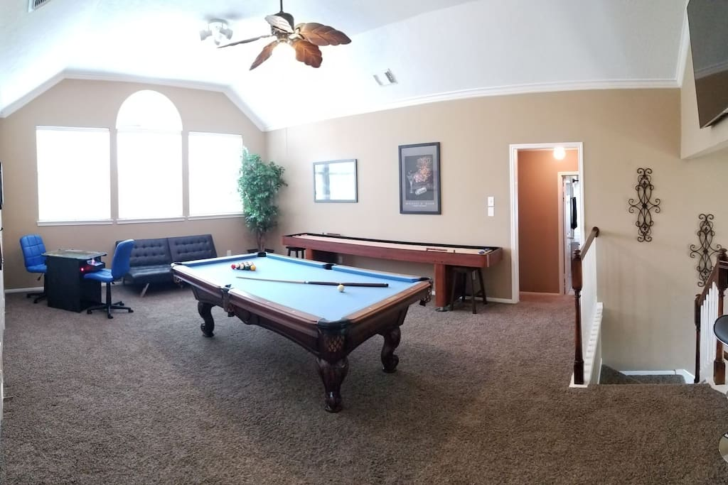 "Extremely spacious upstairs gameroom, complete with: 8' pool table, shuffleboard, custom video arcade game table for two, 60"" Smart TV with multiple Xbox360 games, satellite TV (with premium stations), and Netflix!"
