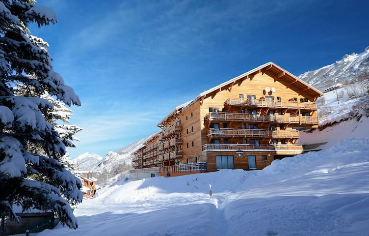Step out onto the fresh powder and admire the beauty of the mountains!