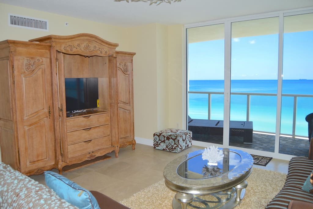 Direct ocean front views from living room with very nice decor throughout the entire apartment.