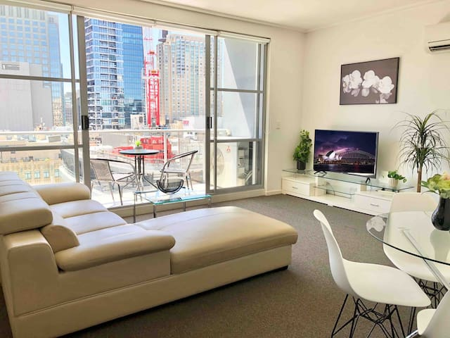 Specious living area leading onto large balcony.