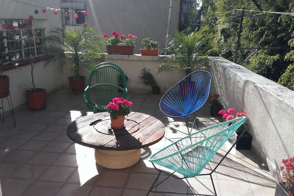 Sunny patio. The window you see in the back is a room  used for storage only by another tenant of the building.
