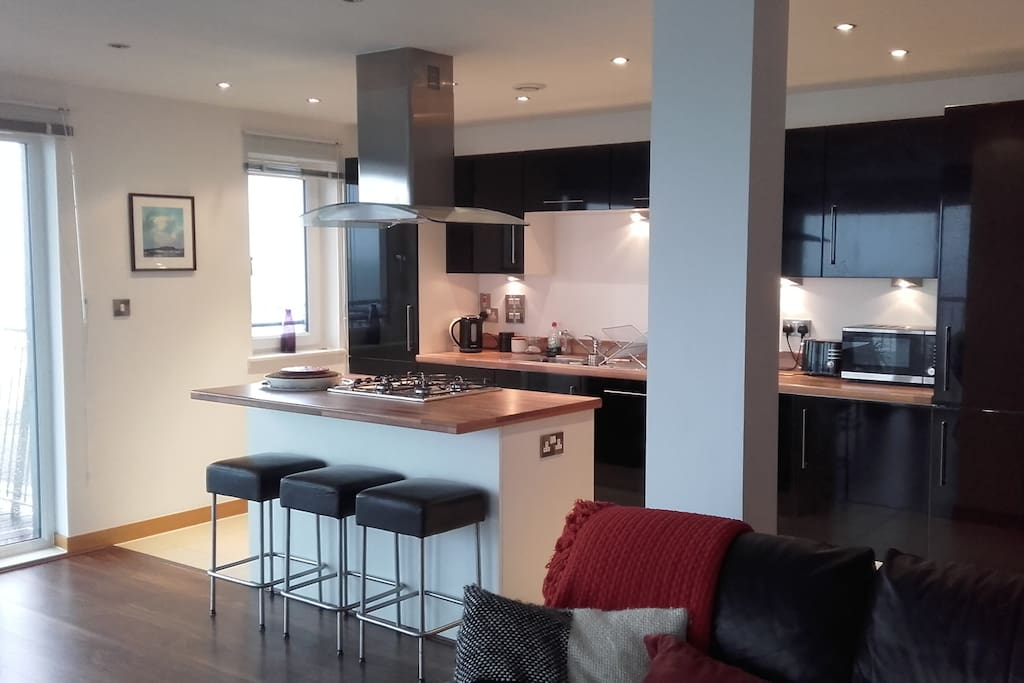 Open plan spacious and well equipped kitchen