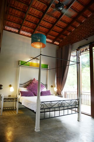 The second room in our Family Villa with 1 queen bed, 1 single bed, attached bathroom, air conditioning and a private terrace..