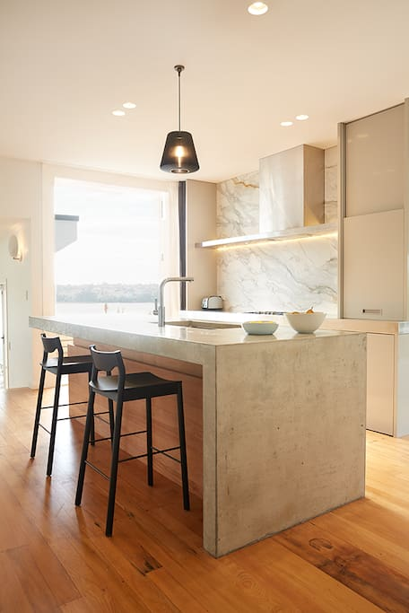 Beautiful kitchen with plenty of space to work at the concrete bench.