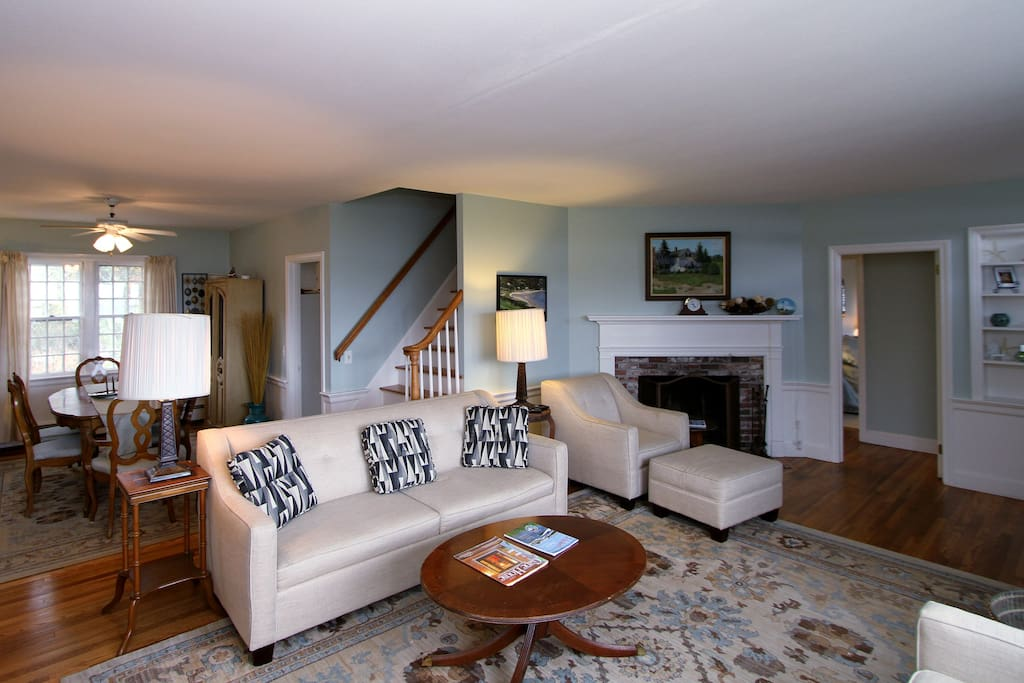 Hard wood floors and rug adorn the living room
