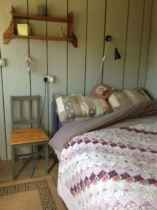 Comfy Double Bed topped with cosy quilts.