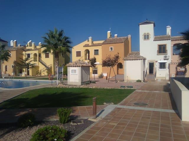 Gated community townhouse with pool, gardens, wifi - Algorfa