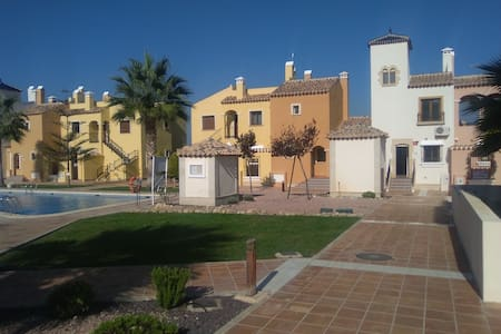 Gated community townhouse with pool, gardens, wifi - Algorfa