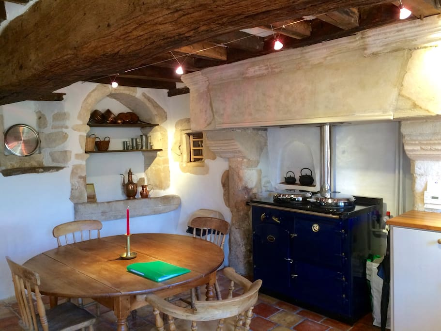 The kitchen is full of beautiful old wood and stone features