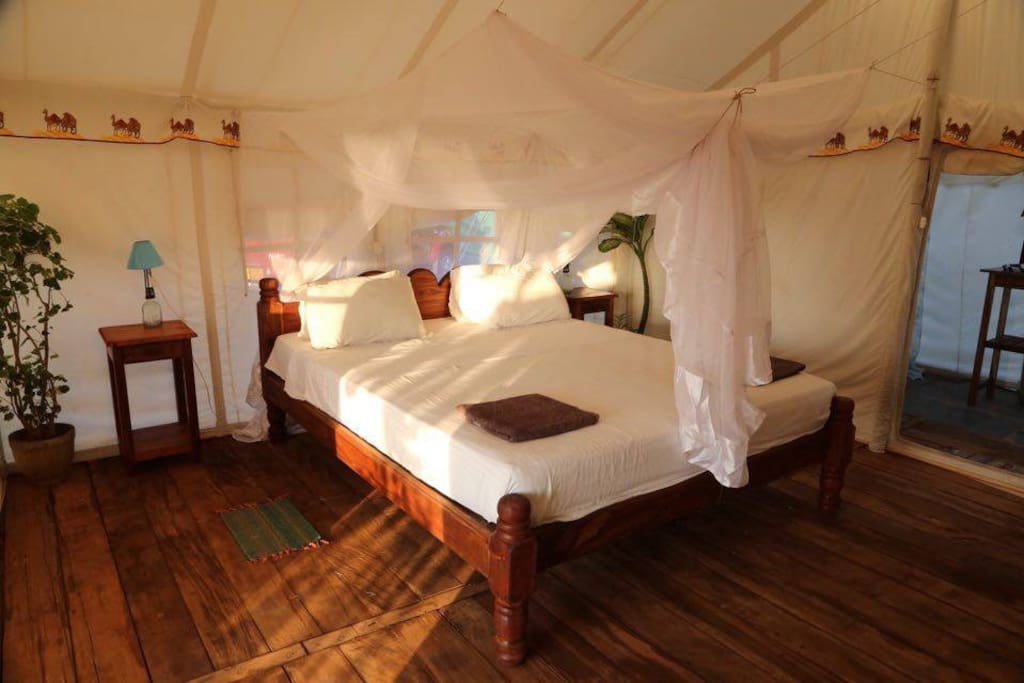 Tent inside with king size bed, comfortable metres and mosquito net