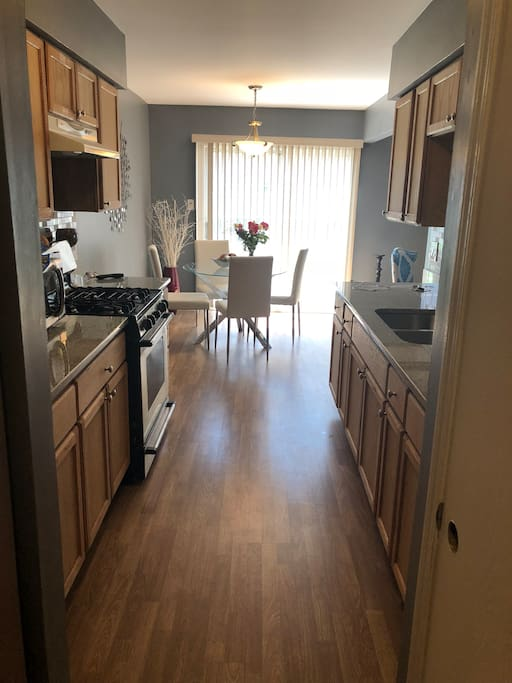 Galley style kitchen leading to patio