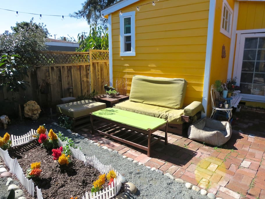 Outdoor seating area in front of the house