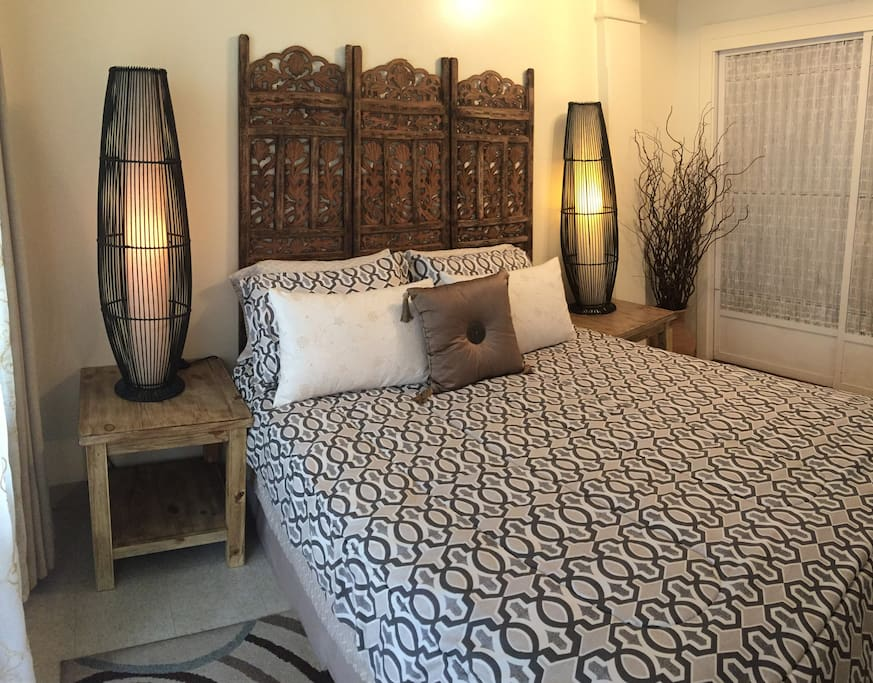 Spacious & Beautifully decorated bedroom with warm tones and lots of local and Hawaiian Charm
