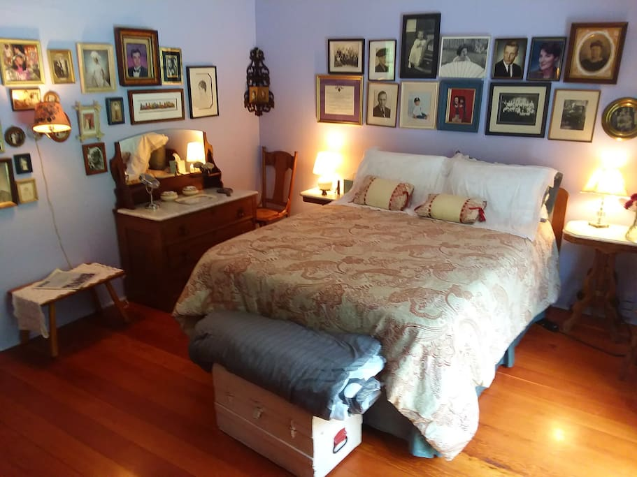 Queen bed with memory foam mattress, dressing tables, hardwood floors, large spacious room adjacent to bathroom, reading/tv room, and private deck.