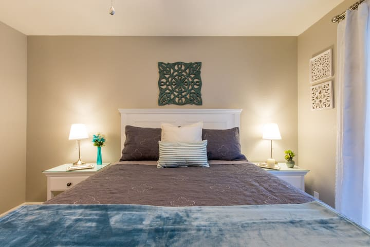 Enjoy the spa like feel of the Master Suite decorated in soothing tones of grey and turquoise