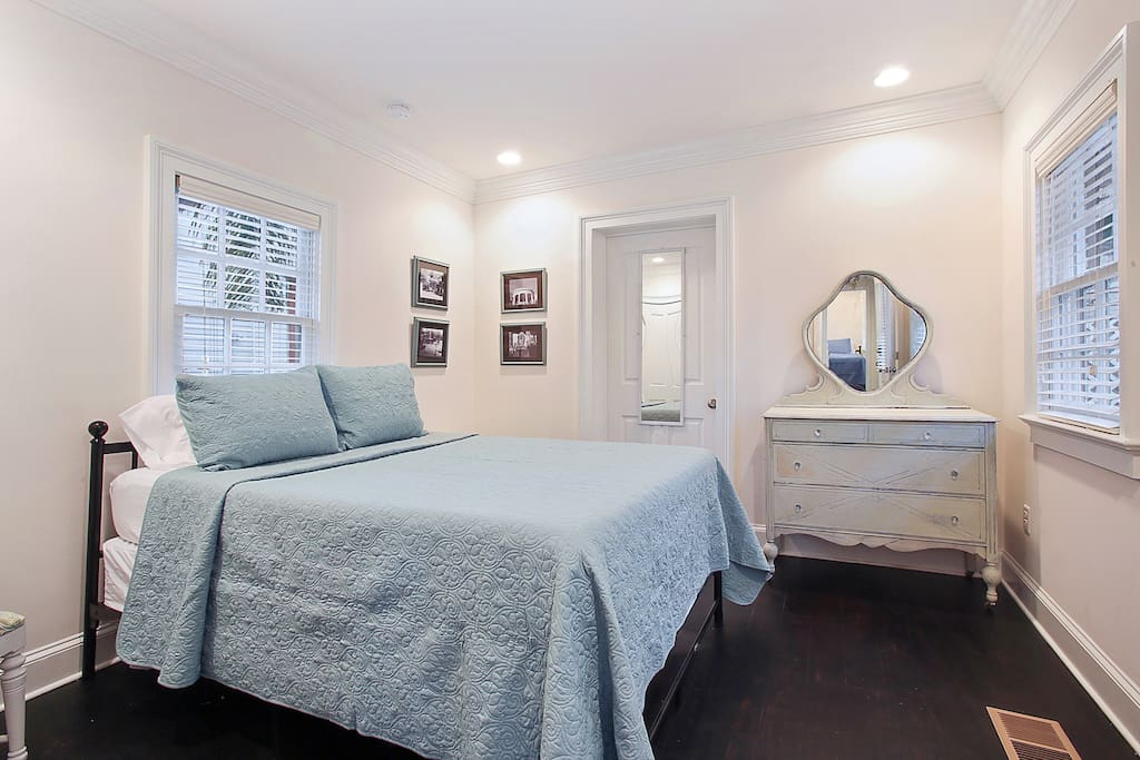 Master bedroom has elegant furnishings and attached bathroom.