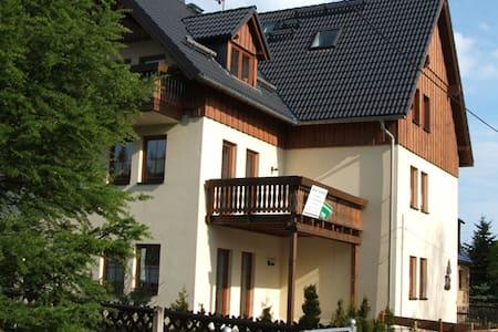 Ferienwohnung mit Balkon direkt an der Kammloipe