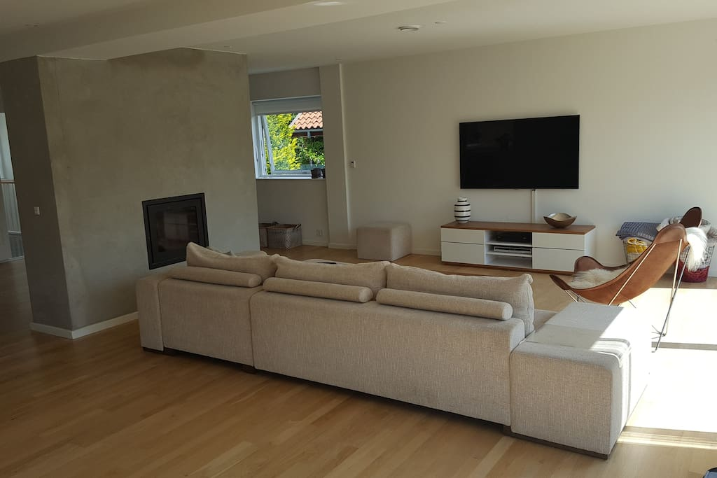 Living room with 60 inch flat screen tv, cable tv, netflix, HBO & PS4