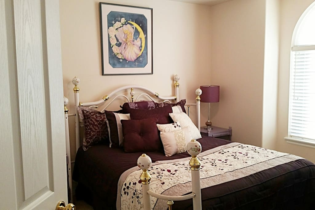 "BEAUTIFUL QUEEN ""PURPLE ROOM"" with queen brass bed, matching mirrored dresser and chair for changing. This room also has a closet for guest use."