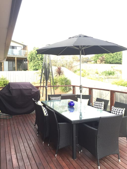 Deck with BBQ, 8 seater outdoor dining and shade umbrella