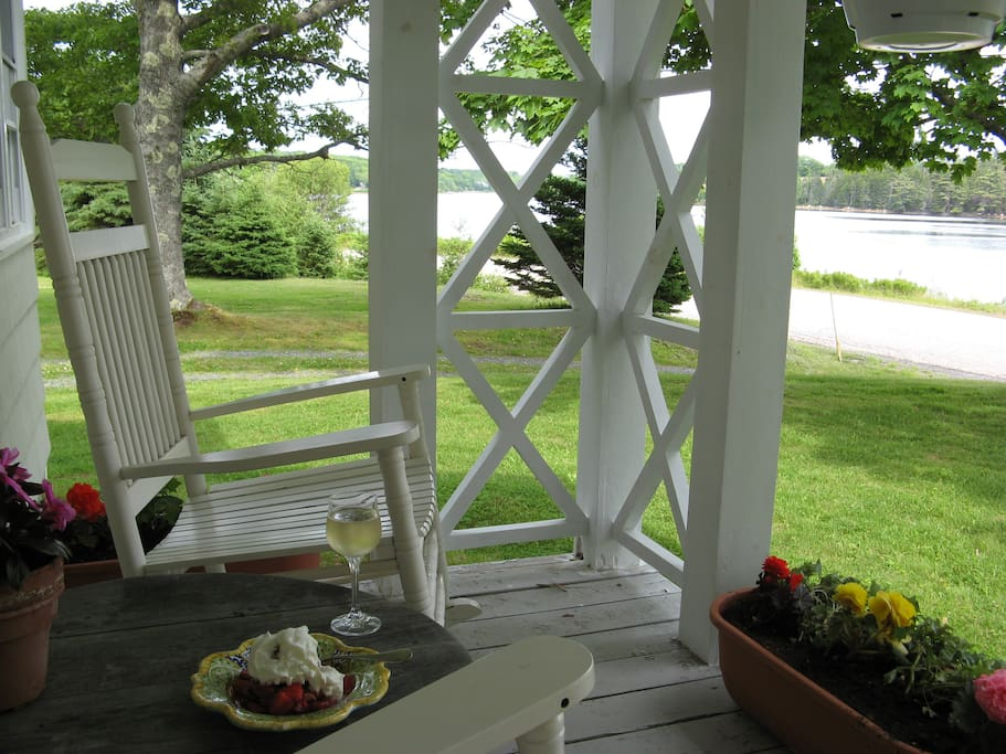 Enjoy the view of the cove from the rockers on the veranda.