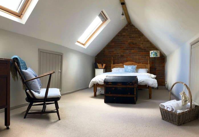 Spacious rustic bedroom.