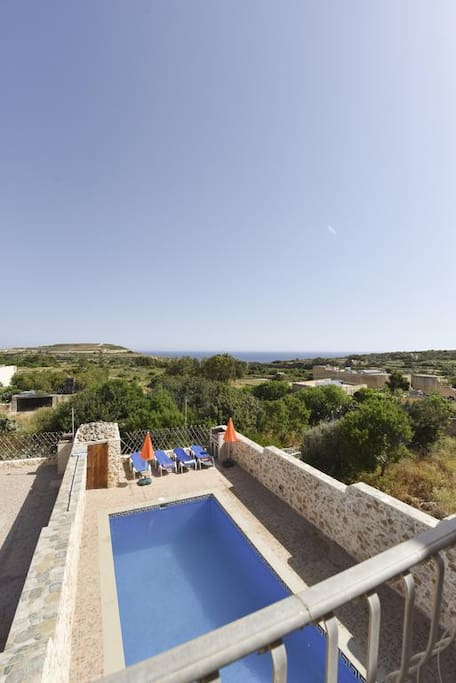 Pool area with unobstructed views