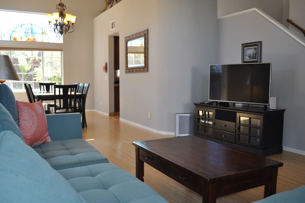 Living room  large brand new couch.  large dinning room table. HD cable TV WiFi
