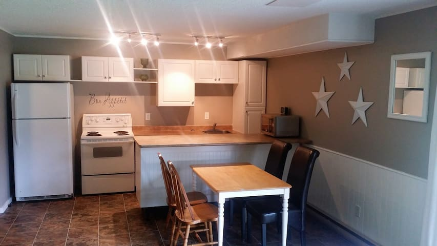 Kitchen - fully equipped with fridge, stove, dishwasher, microwave and dishes.