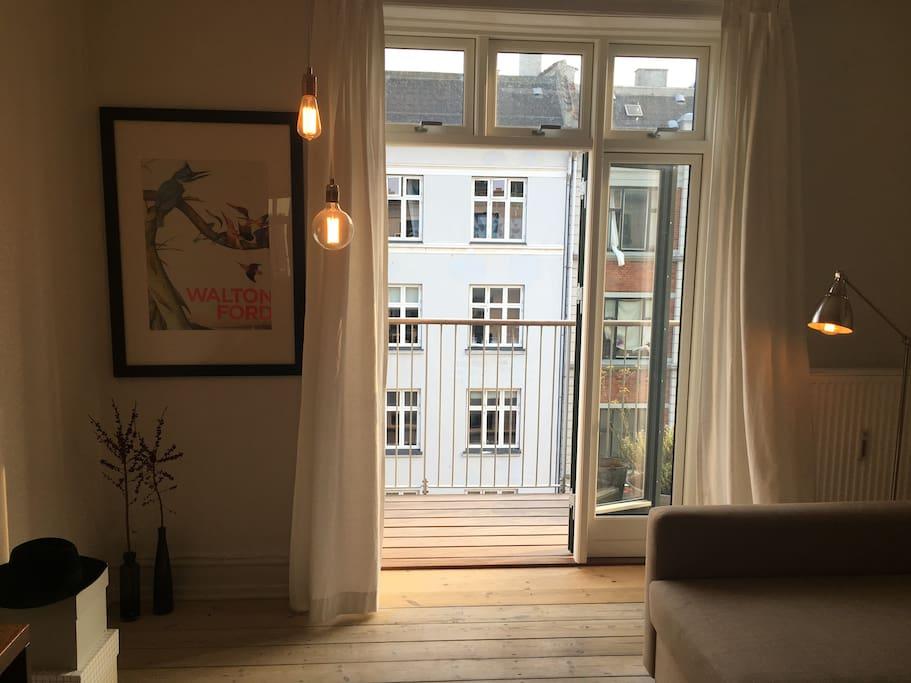 The balcony has double doors