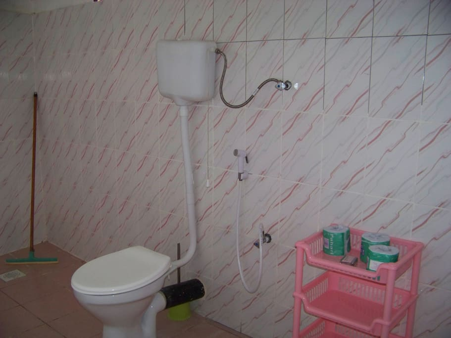 Big airy tiled bathrooms with Western style toilets.