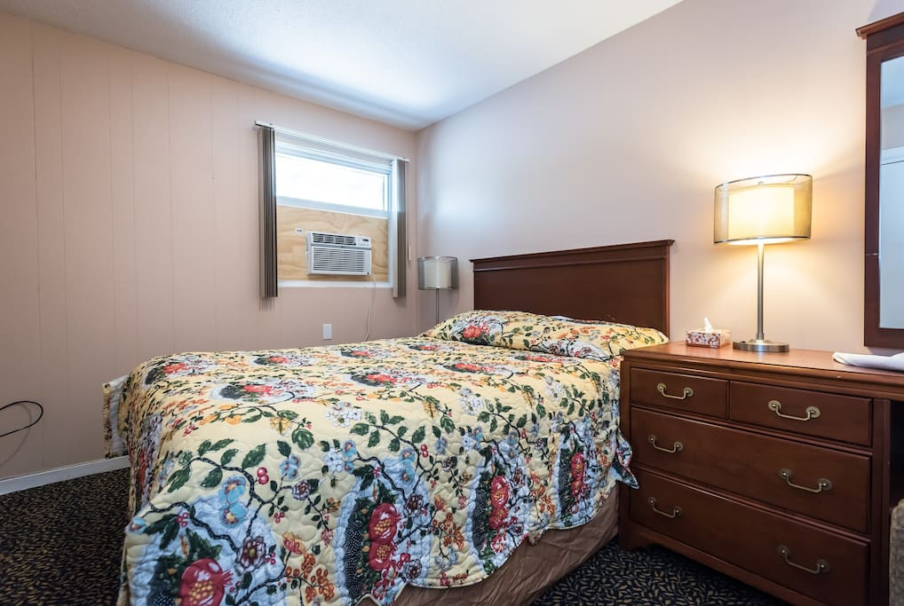 Queen bed in one of the rooms.