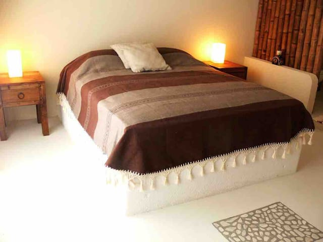 Queen size bed with view at the terrace,  private bathroom and shower