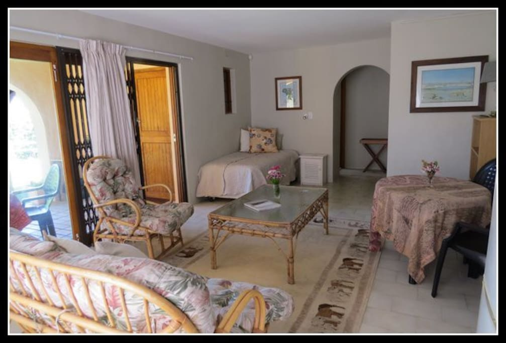 Bright, spacious lounge with third person single bed.