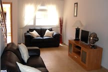 Lounge with 2 leather sofas, UK TV