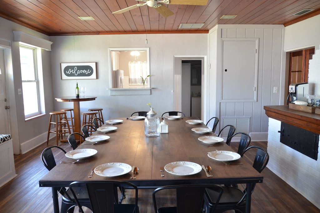 The dining room features a large table for 12 with additional bar height seating for 4. It also has a large window seat overlooking the private courtyard.