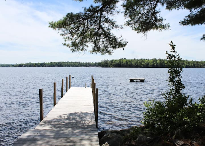 Timeless lakefront home on Lake Winnipesaukee with screened-in porch and dock