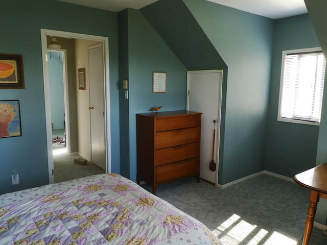 Main upstairs bedroom. View to hallway with 1/2 bathroom