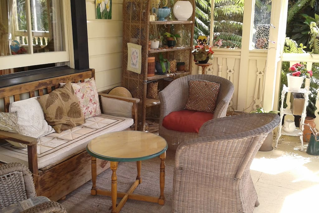 The top porch balcony which is surrounded by trees and looks out to the ocean. Great for relaxing with a cup of tea and cake after your busy day