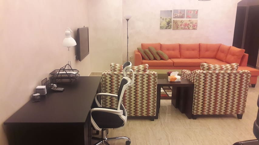 """Living room opened to the kitchen with 48"""" smart LCD & cable box"""