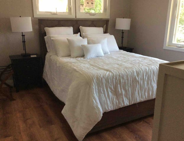 Master bedroom with Queen size bed and built in dresser Master bath has walk in shower