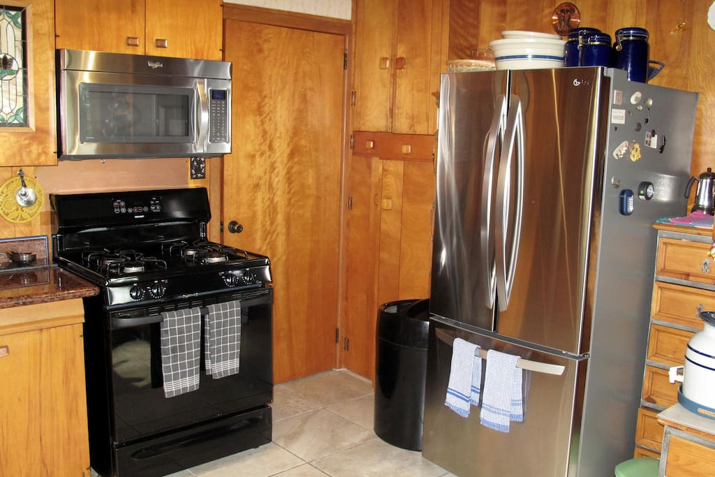 Modern appliances including new refrigerator, microwave and dishwasher.